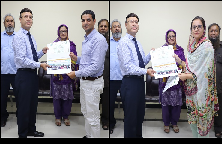 Prof. Dr. M. Akram Shaik distributing certificates among the training workshop participants of SPSS held from 29-31 July, 2019 at PASTIC