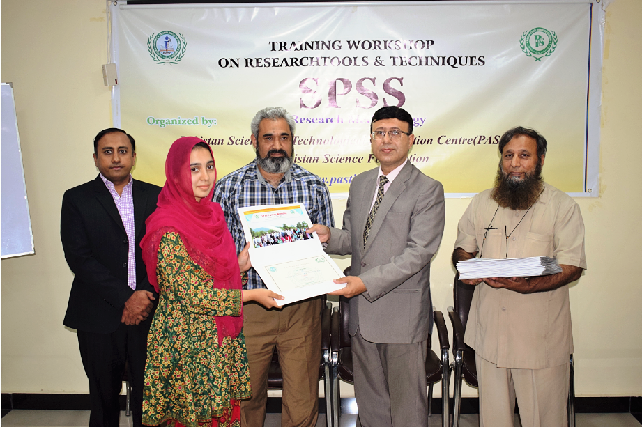 Participant receiving certificate on closing ceremony of 'Training Workshop on Research Tools & Techniques using SPSS Software' at PASTIC, Islamabad. (12<sup>th</sup>, July 2018)