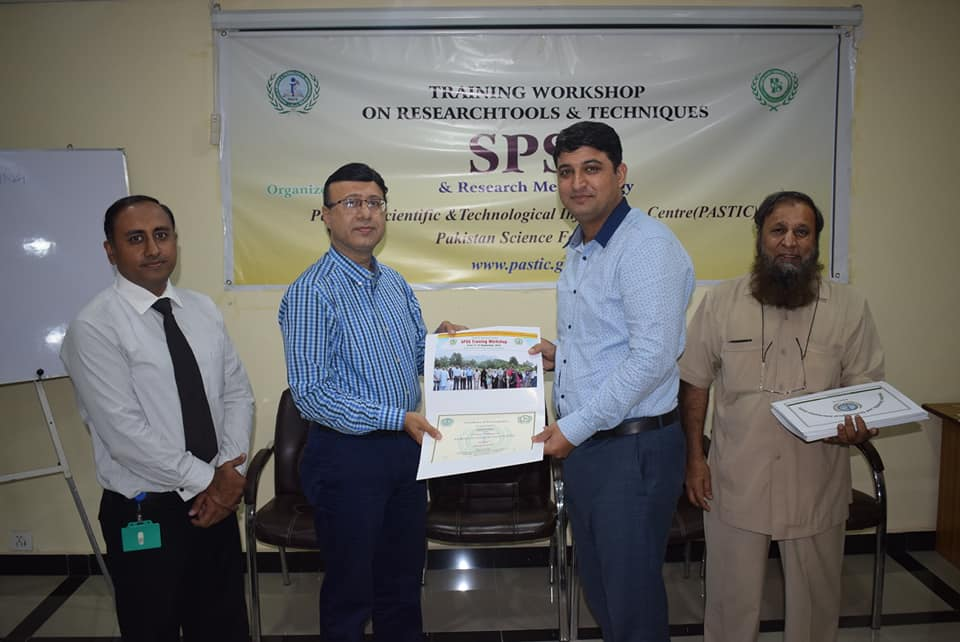 Participant receiving certificate on closing ceremony of 'Training Workshop on Research Tools & Techniques using SPSS' at PASTIC National Center, Islamabad. (13<sup>th</sup> September, 2018)