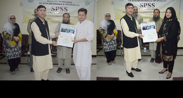 D.G PASTIC distributing SPSS Training Workshop certificates among the participants held from 27-29 March, 2019 at PASTIC National Centre