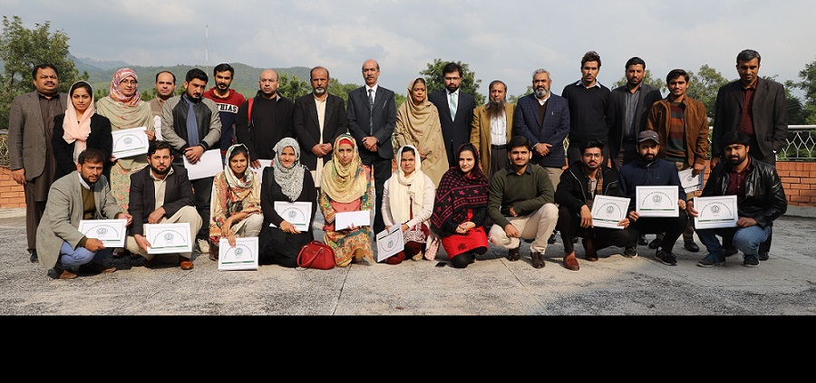 Group photo of the participants of SPSS Training Workshop with Mr. Muhammad Hanif, Deputy Secretary Ministry of Science & Technology, organized by PASTIC National Centre, Islamabad from 26-28 November, 2019 at PASTIC National Centre, Islamabad